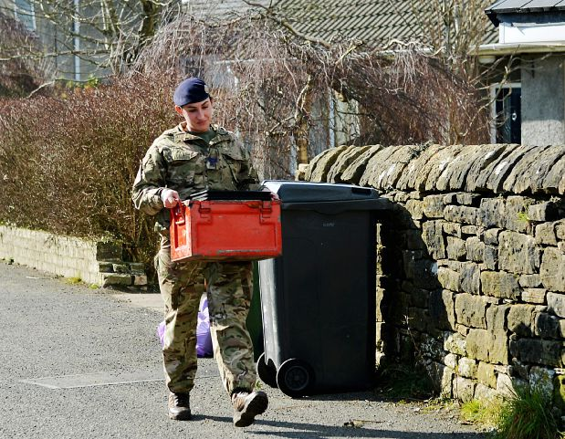 Bomb Disposal experts were called in when builders working on a house on Quality Corner, Seaton discovered what they thought was an unexploded shell. Bomb disposal staff remove the item. Pic Tom Kay        Thursday 10th March 2016 50083460T012.JPG