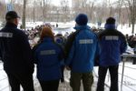 OSCE mission employees look at protesters during a rally in front the OSCE mission in Donetsk on Febtuary 15, 2017. The protesters accused the deputy Chief Monitor of the OSCE Special Monitoring Mission (SMM) to Ukraine, Alexander Hug,  of inaction.  / AFP PHOTO / Aleksey FILIPPOV