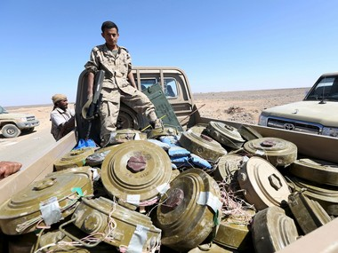 A soldier loyal to Yemen's government stands on the back of a truck transporting landmines left by the Houthi rebels in al-Jadaan area, which was taken by pro-government army from the Houthis, in the country's central province of Marib, December 21, 2015. REUTERS/Ali Owidha - RTX1ZMW1