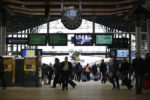 Commuters and travellers walk through the Gare du Nord railway station on November 16, 2015 in Paris, three days after the terrorist attacks that left over 130 dead and more than 350 injured. France prepared to fall silent at noon on November 16 to mourn victims of the Paris attacks after its warplanes pounded the Syrian stronghold of Islamic State, the jihadist group that has claimed responsibility for the slaughter.  AFP PHOTO / KENZO TRIBOUILLARD / AFP / KENZO TRIBOUILLARD