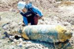 villagers-in-kong-pisei-district-kampong-speu-province-discover-an-american-m117-bomb.-supplied