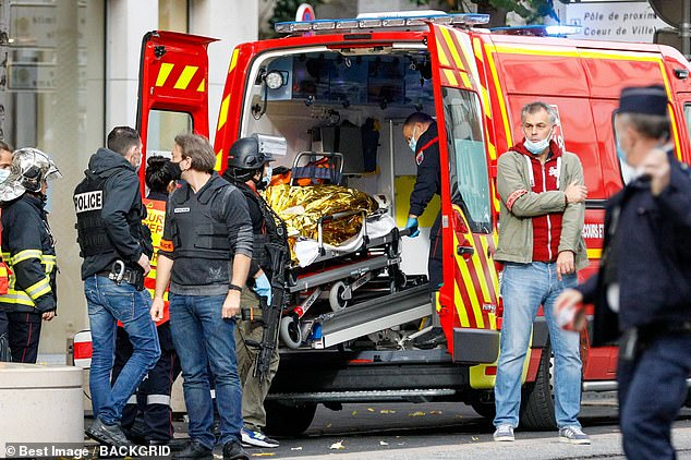 34998054-8893203-A_person_who_was_wounded_during_the_attack_on_a_cathedral_in_Nic-a-22_1603976237767